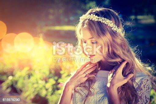 istock Romantic Bride on Warm Nature Background 615976290