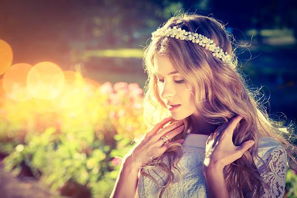 romantic bride on warm nature background - hochzeitsfrisur boho stock-fotos und bilder