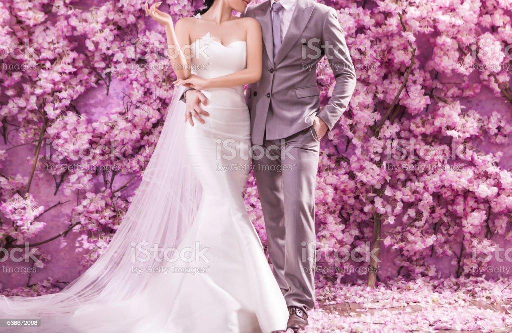 Romantic bridegroom kissing bride on forehead stock photo