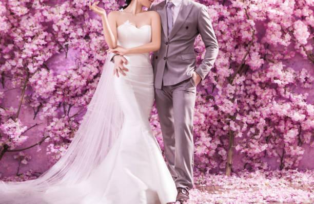 Romantic bridegroom kissing bride on forehead stock photo