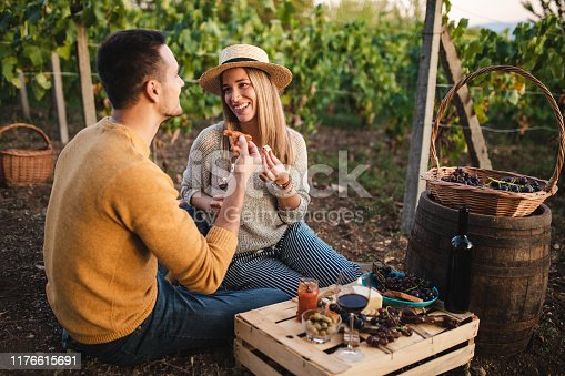 Happy Young Couple Having Fresh Branch And Glass Of Organic Wine While Playing With Adorable Jack Russel Terrier