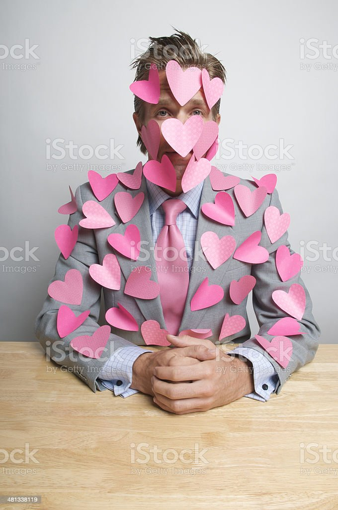 Romantic Businessman Office Worker Pink Hearts at Desk royalty-free stock photo