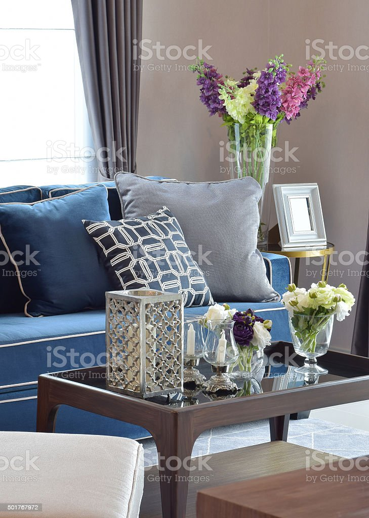 Romantic candle set with blue sofa in living room stock photo