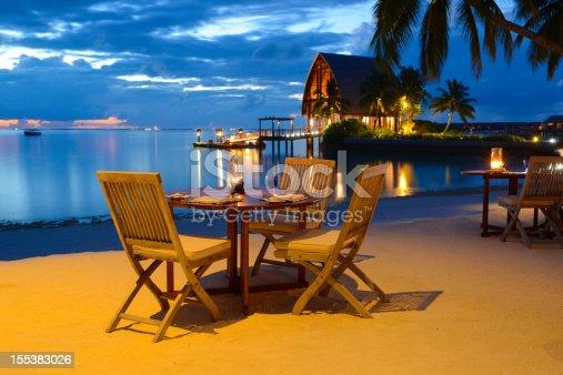 istock Romantic Candlelight Beach Dinner at Seaside Restaurant 155383026