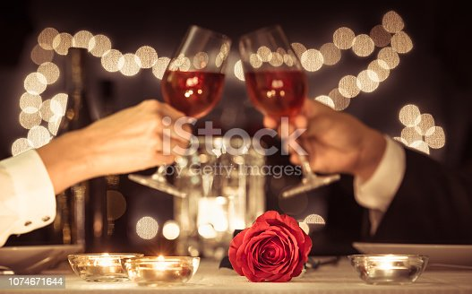 Happy couple having a romantic candlelight dinner.