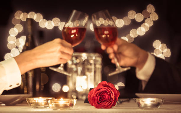 Romantic candlelight dinner Happy couple having a romantic candlelight dinner. table for two stock pictures, royalty-free photos & images