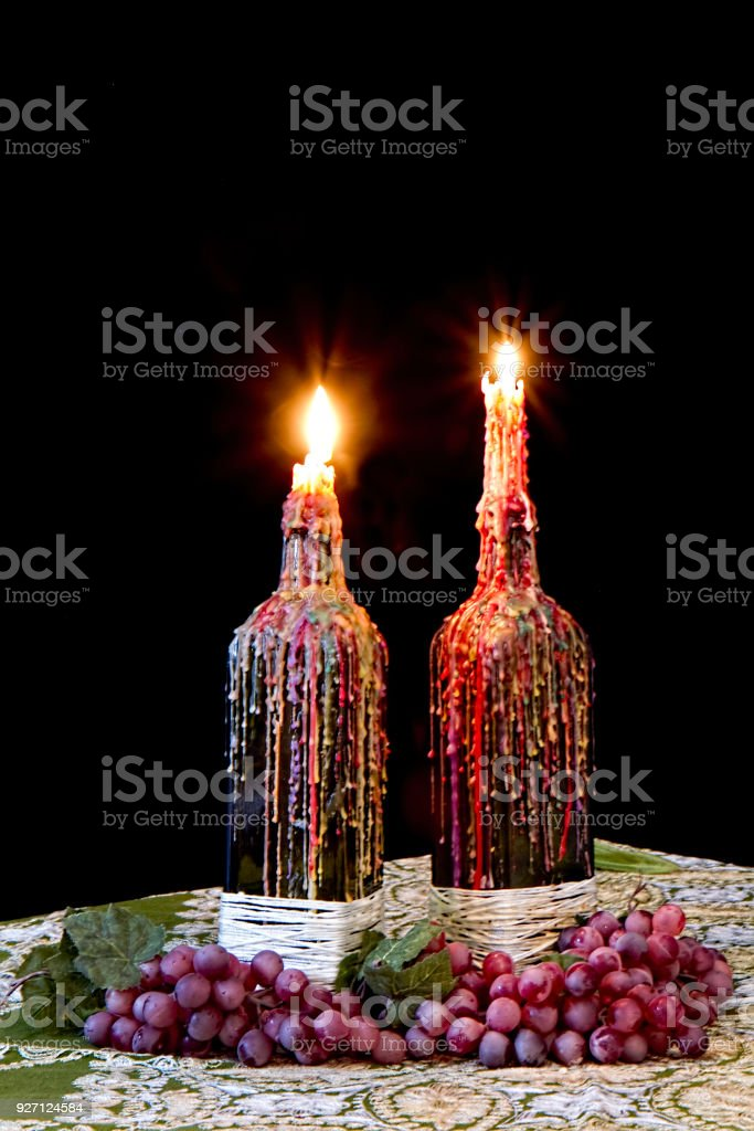Romantic Candles In Wine Bottles Dripping Wax Stock Photo More