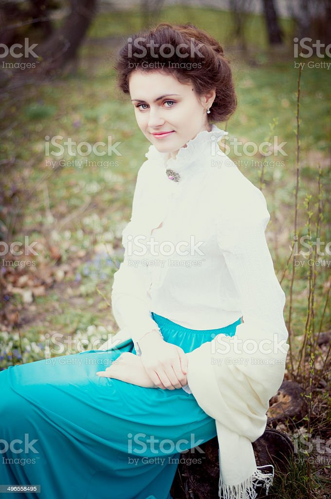 Romantic caucasian woman in vintage outfit. Retro style stock photo