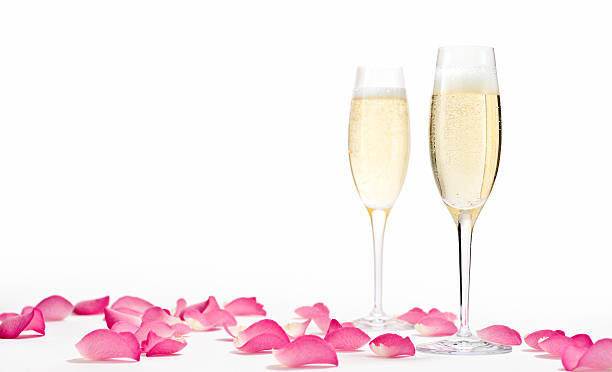romantic champagne horizontal - rose petals stock pictures, royalty-free photos & images