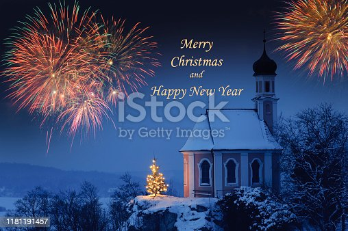 istock romantic Christmas chapel in snow at night 1181191457