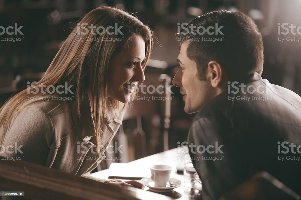Romantic couple at the bar stock photo