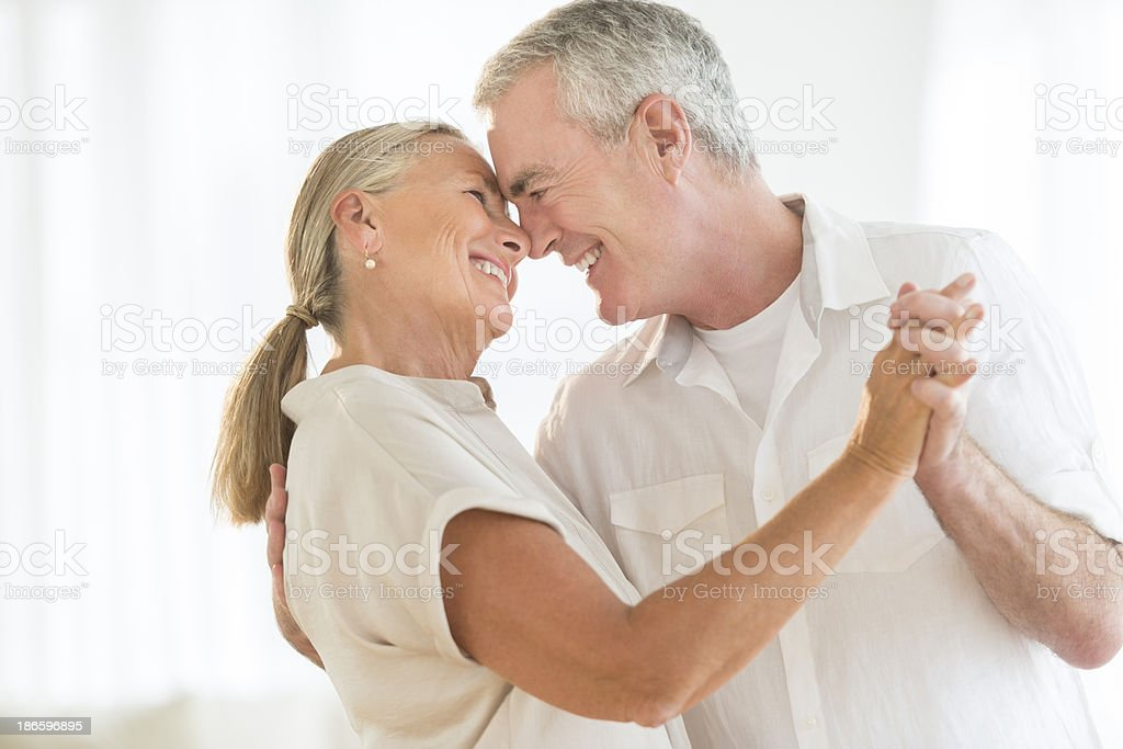 Romantic Couple Dancing At Home stock photo