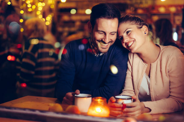 Romantic couple dating in pub at night Romantic young couple dating in pub at night date night romance stock pictures, royalty-free photos & images