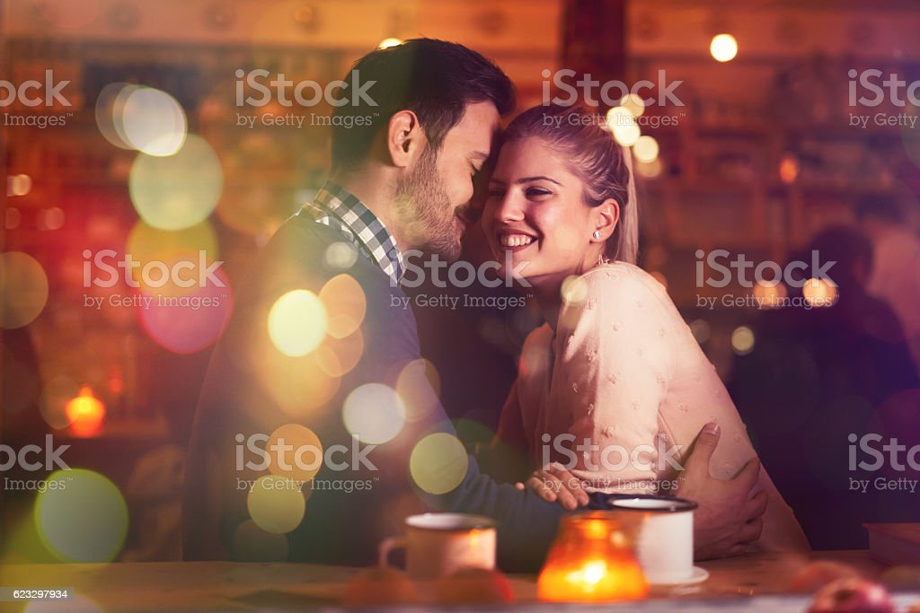 Romantic couple dating in pub stock photo