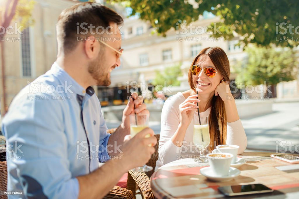 Romantic couple drinking coffee, having a date in the cafe. Dating, love, relationships foto de stock royalty-free
