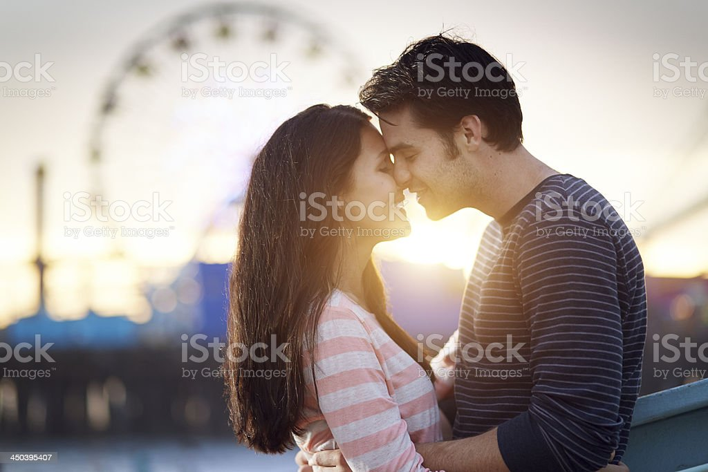 romantic couple embracing  at sunset stock photo