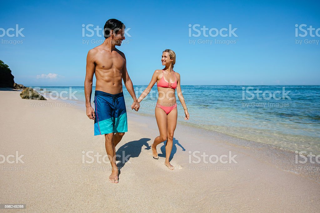 Romantic Couple Enjoying Beach Vacation Royalty Free Stock Photo