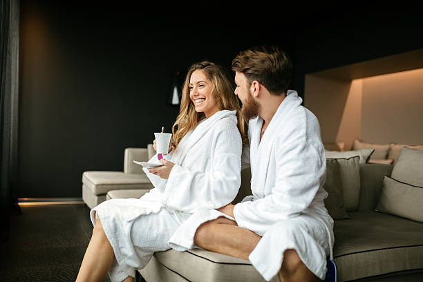 romantic couple enjoying honeymoon escape - tratamiento de spa fotografías e imágenes de stock