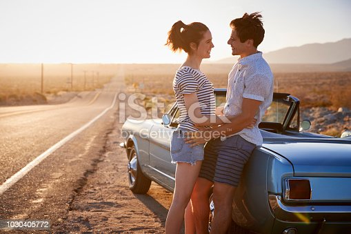 1030408008istockphoto Romantic Couple Enjoying Road Trip In Classic Car 1030405772
