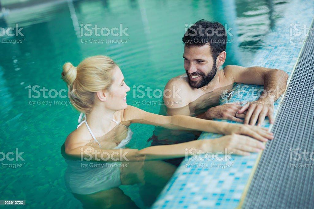 Romantic couple enjoying thermal bath stock photo