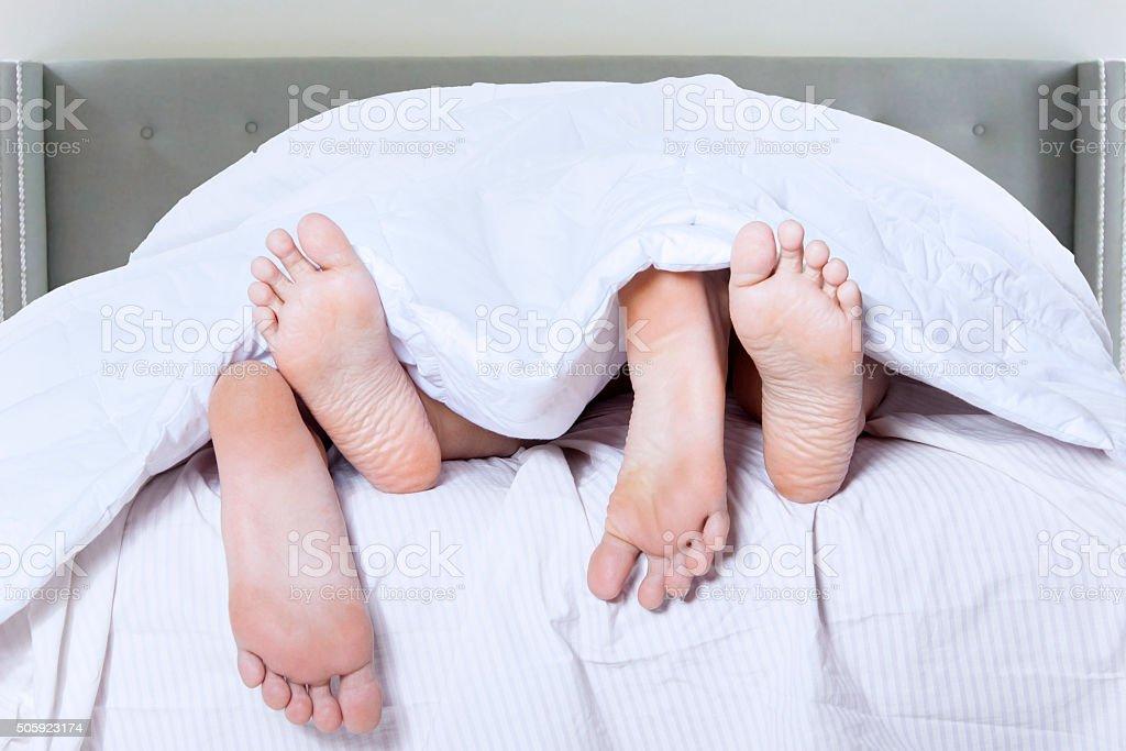 Romantic couple feet sleep in bedroom royalty free stock photo. Romantic Couple Feet Sleep In Bedroom stock photo   iStock