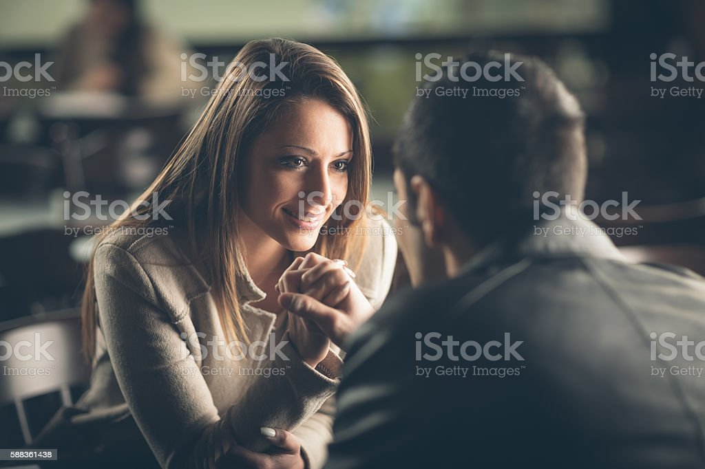 Romantic couple flirting at the bar stock photo
