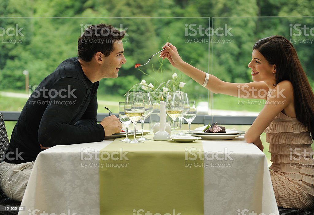 Romantic couple having fun during the lunch royalty-free stock photo