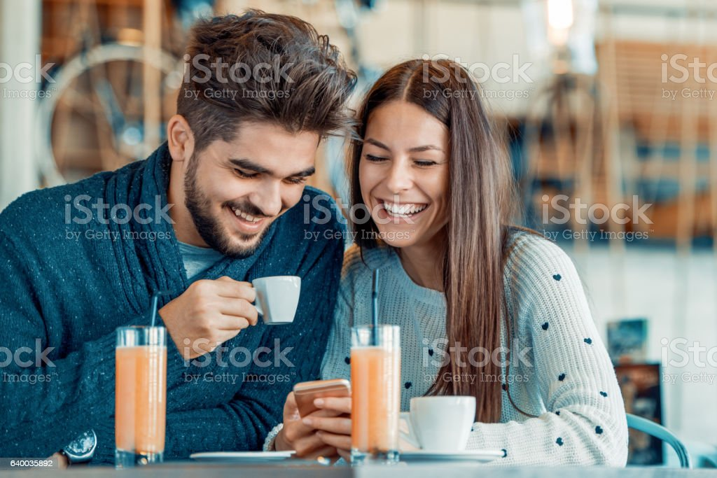 Romantic couple having rest in cafe stock photo
