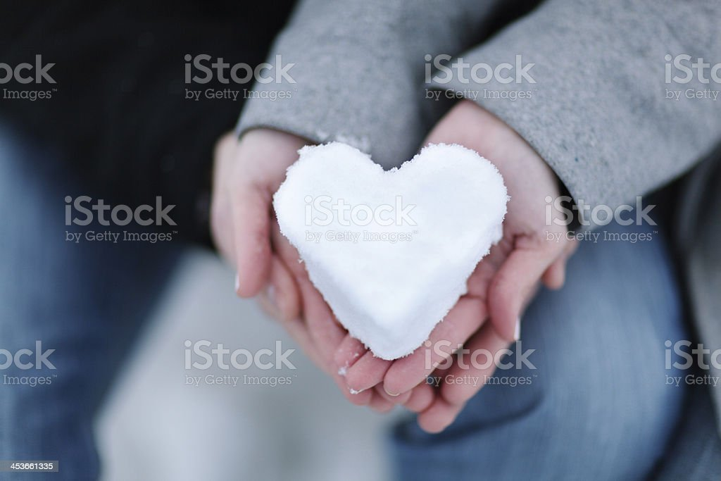 Romantic Couple Holding Heart made with Winter Snow Horizontal stock photo