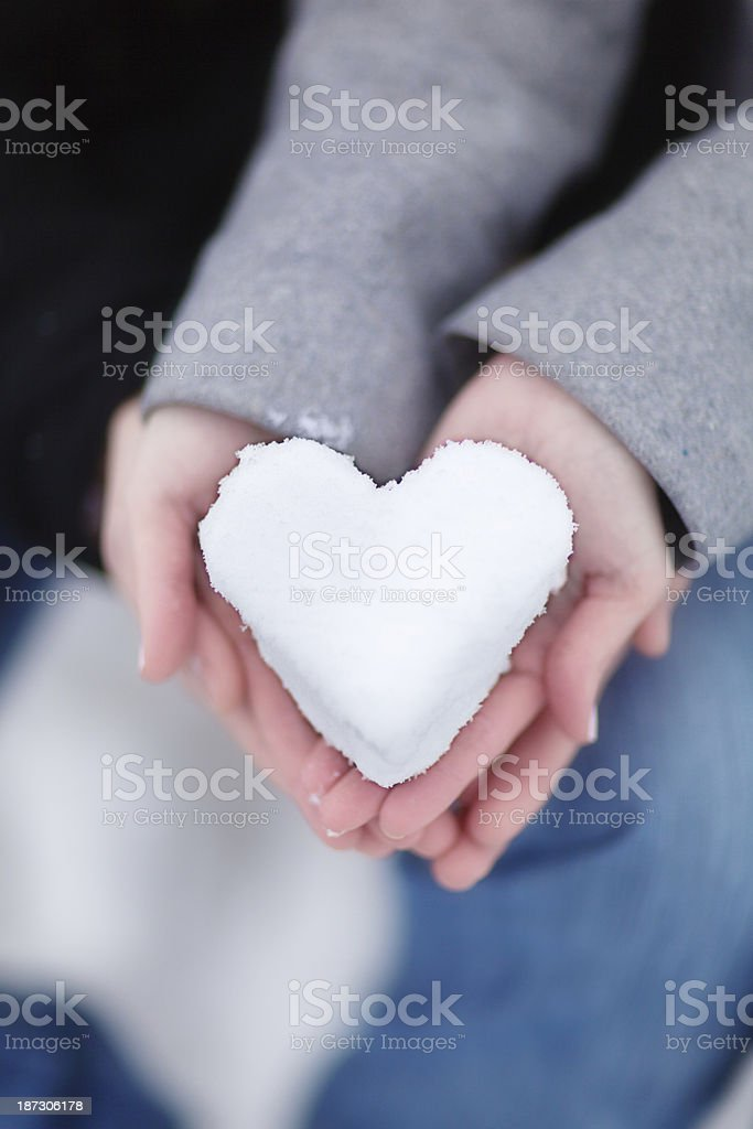 Romantic Couple Holding Heart made with Winter Snow Vertical stock photo