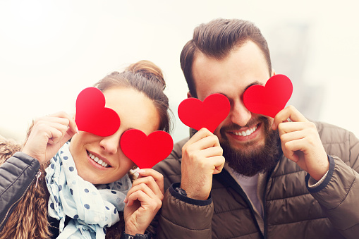 Picture of romantic couple having fun with hearts