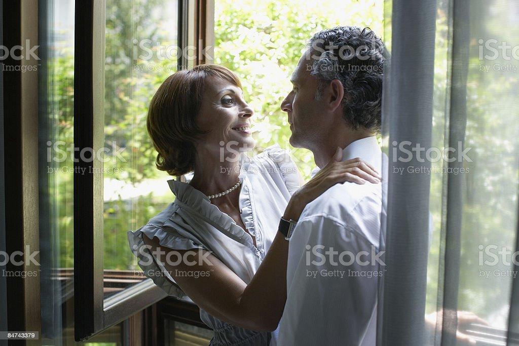 Romantic couple hugging near window royalty-free stock photo