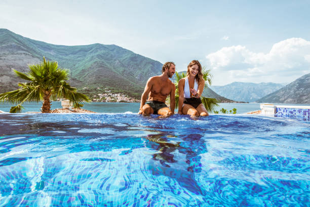 romantic couple in a pool stock photo