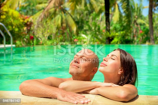 1055009962 istock photo Romantic couple in a pool 546784142