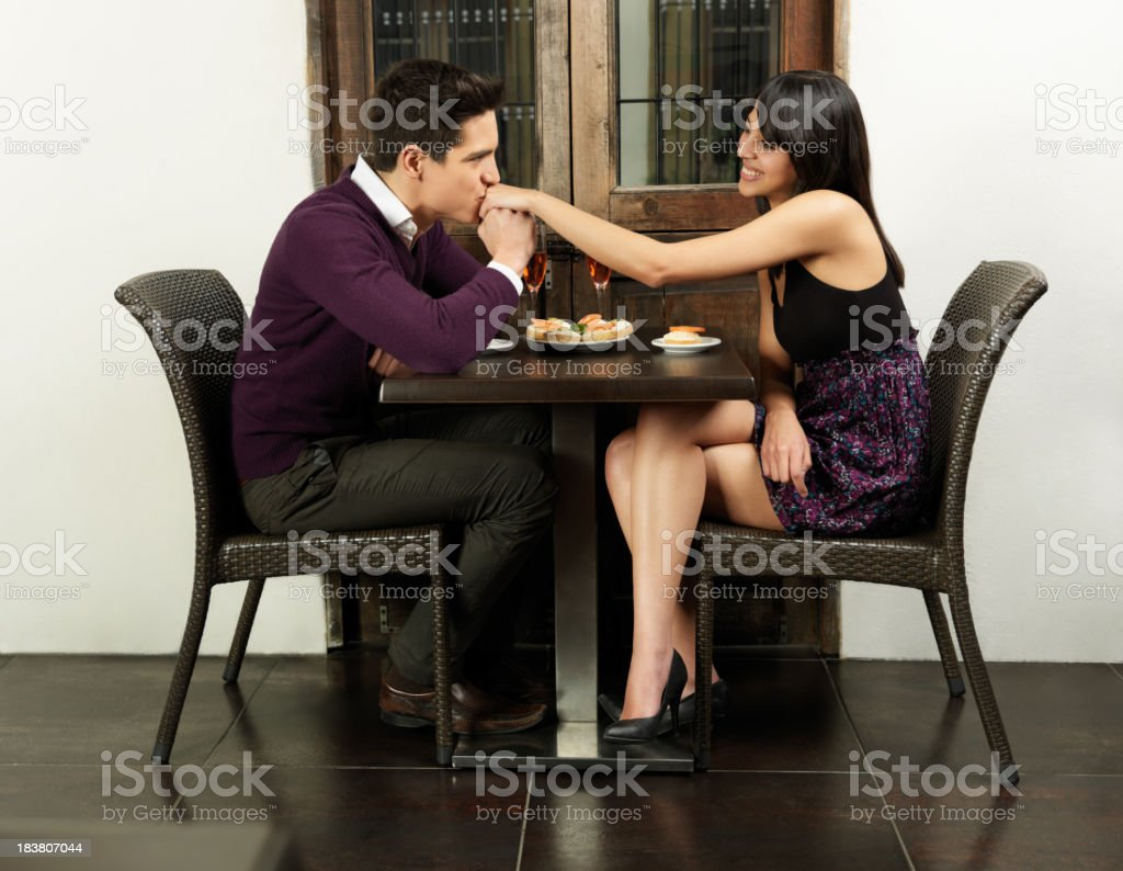 Romantic couple in a restaurant royalty-free stock photo