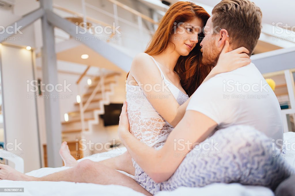 Romantic couple in love lying on bed royalty free stock photo. Romantic Couple In Love Lying On Bed stock photo   iStock