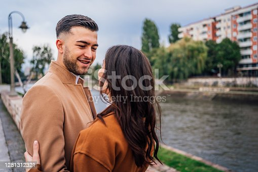 Young romantic couple in love near the river