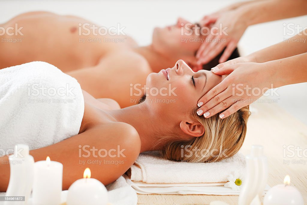 Romantic couple is having a head massage at spa centre. royalty-free stock photo