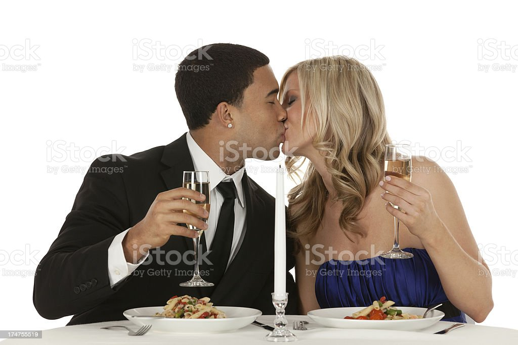 Romantic couple kissing each other at a dining table royalty-free stock photo
