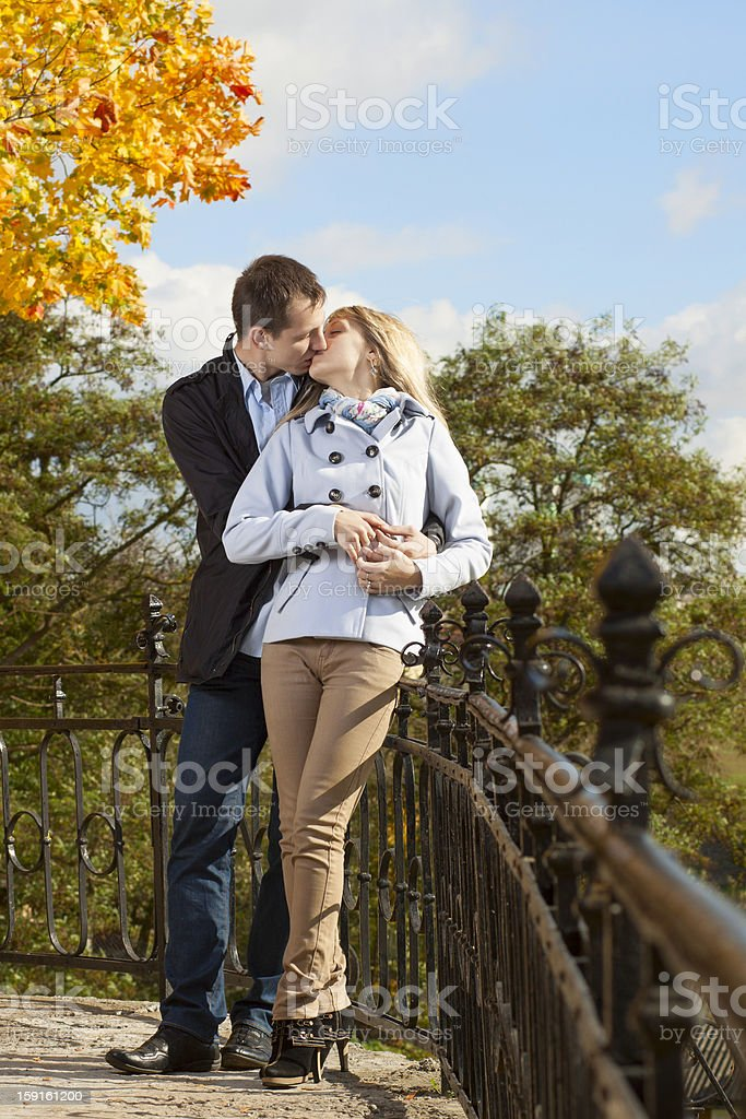 Romantic couple kissing in autumn park royalty-free stock photo