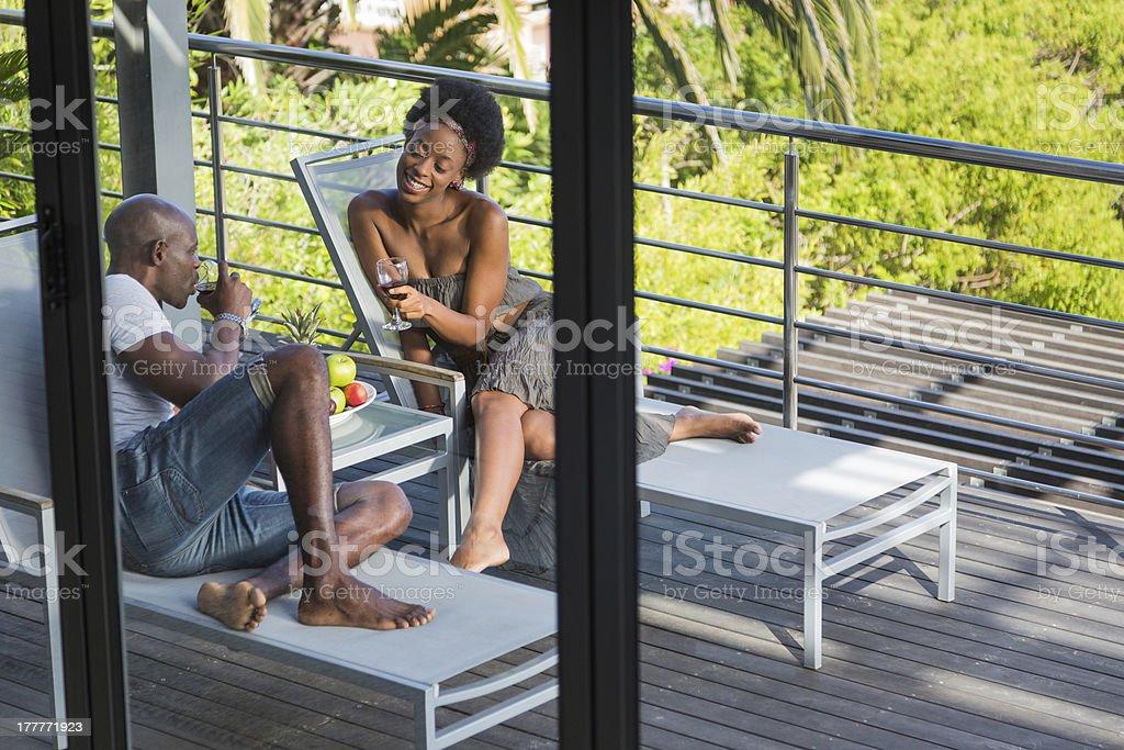 Romantic Couple on Vacation, Shot Through a Window stock photo