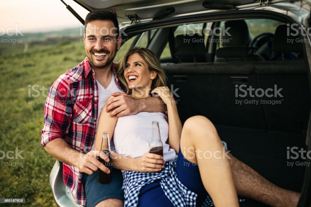 Romantic couple outdoor sitting in the car zbiór zdjęć royalty-free