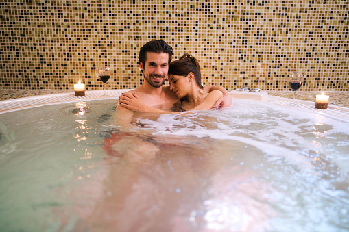 Romantic Couple Relaxing In Hot Tub At Health Spa Stock ...