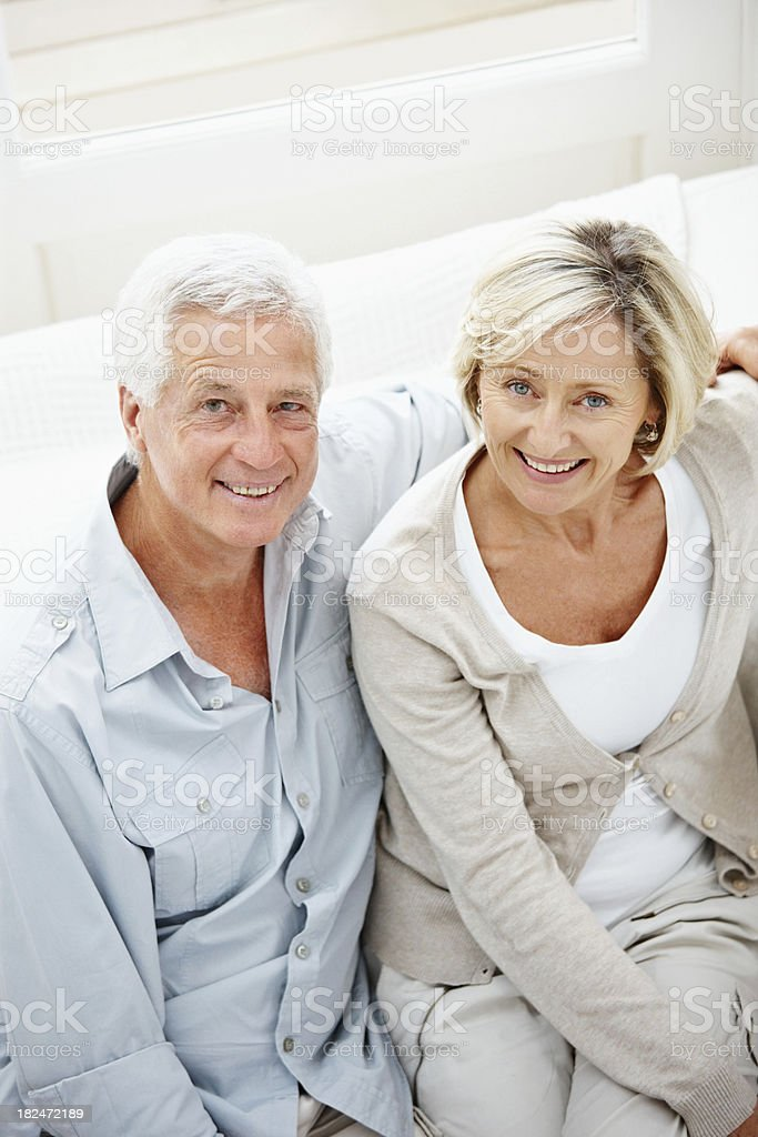 Romantic couple sitting together at home royalty-free stock photo