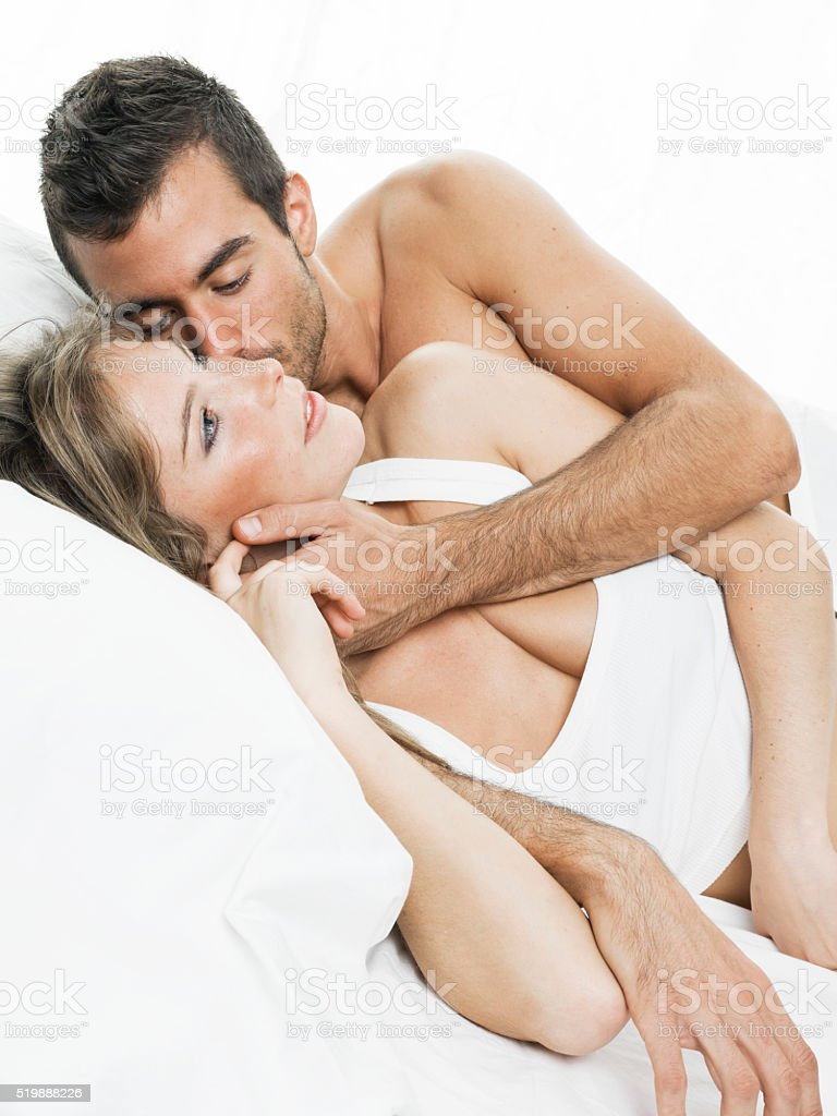 romantic couple sleeping in a white bed royalty free stock photo. Romantic Couple Sleeping In A White Bed stock photo   iStock
