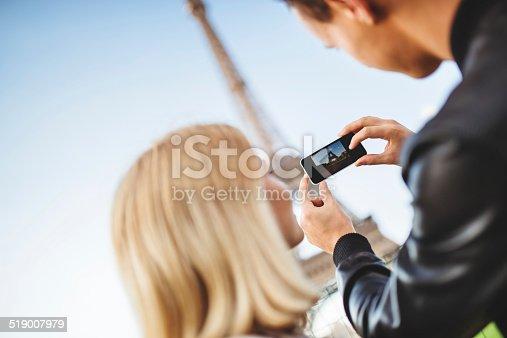 636330566istockphoto romantic couple taking a photo on Paris 519007979