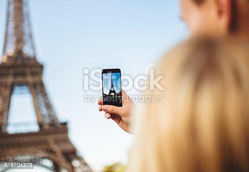 636330566istockphoto romantic couple taking a photo on Paris 519704373