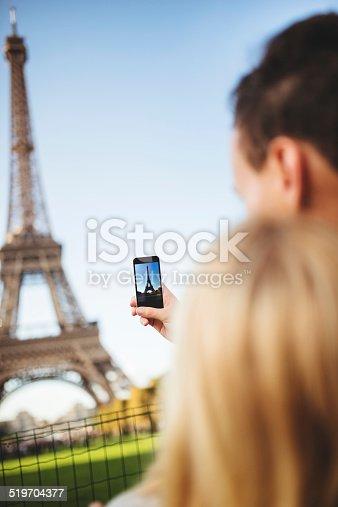 636330566istockphoto romantic couple taking a photo on Paris 519704377