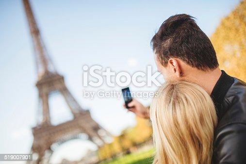 636330566istockphoto romantic couple taking a selfie on Paris 519007901