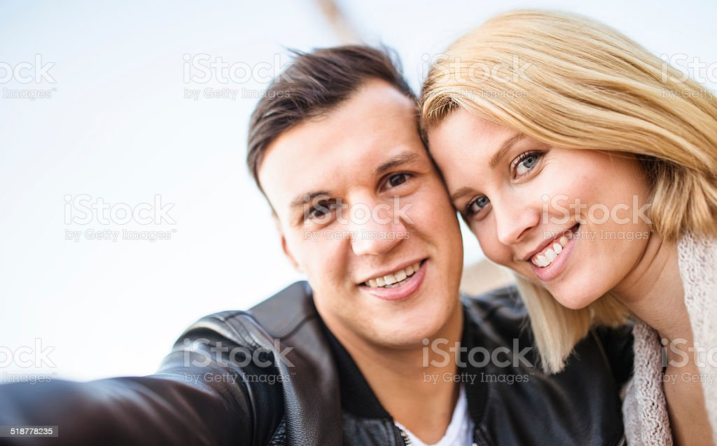 romantic couple taking a selfie togetherness stock photo